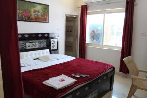 Cama o camas de una habitación en Hotel Sunset