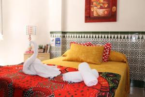 Кровать или кровати в номере Hostal Estación