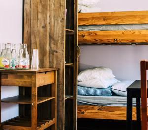 A bunk bed or bunk beds in a room at Skårs gård