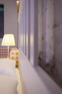 A bed or beds in a room at Nafsika Luxury Suite