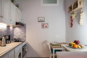 A kitchen or kitchenette at Nafsika Luxury Suite