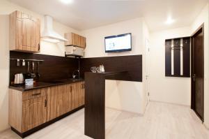 A kitchen or kitchenette at Hotel City Sportivnaya