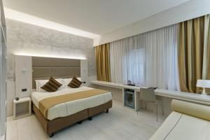 Кровать или кровати в номере Agape Hotel