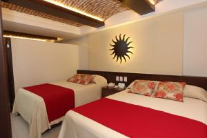 A bed or beds in a room at Las Flores Beach Resort