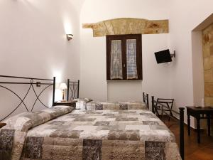 A bed or beds in a room at B&B Cinisi Vacanze