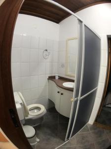 Um banheiro em Pousada Bizkaia