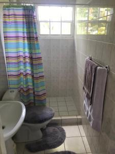 Um banheiro em Quinta Villa