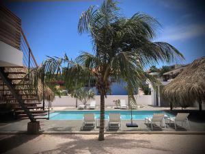 A piscina localizada em La Vista Luxury Apartment Jan Thiel ou nos arredores