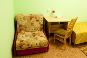A seating area at Molodezhnaya Hotel