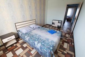 Кровать или кровати в номере апартаменты Бастион