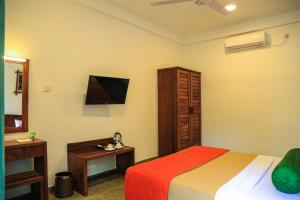 A bed or beds in a room at Fresco Water Villa