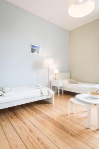 Ein Bett oder Betten in einem Zimmer der Unterkunft Johanniterhaus Wittenberg