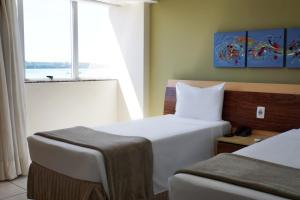 A bed or beds in a room at Nobile Suites Diamond