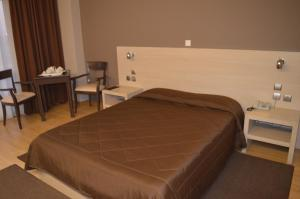 A bed or beds in a room at Achillio Hotel