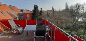 Ein Balkon oder eine Terrasse in der Unterkunft Ferienwohnung Am Schwanensee