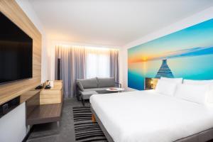 Cama o camas de una habitación en Hotel Novotel Brussels Off Grand Place