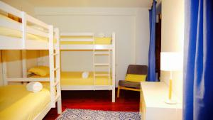 A bunk bed or bunk beds in a room at Ideas Peregrinas