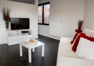 A television and/or entertainment centre at Jane's Corner The Place To Read&Eat&Sleep