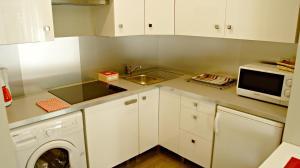 A kitchen or kitchenette at Little Suite - Ferdinand