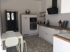 A kitchen or kitchenette at Demeure de charme LES RICEYS