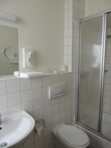 Ein Badezimmer in der Unterkunft CVJM Düsseldorf Hotel & Tagung