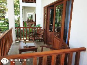 A balcony or terrace at Blue Turtle Hotel