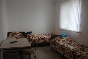 Кровать или кровати в номере Гостиница имени 9 мая