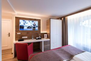 A television and/or entertainment center at Hotel Butterfly, BW Signature Collection