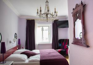 Cama o camas de una habitación en das HOTEL in München