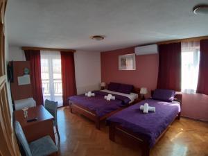 Postel nebo postele na pokoji v ubytování House Šapina