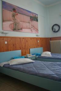 Ένα ή περισσότερα κρεβάτια σε δωμάτιο στο Diamanto Rooms