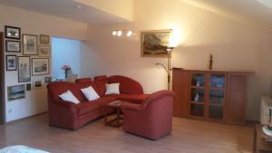 Ein Sitzbereich in der Unterkunft Altstadt-Ferienwohnung Rodica