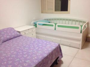 A bed or beds in a room at Apto. n. 208 no Cond. Cumaru