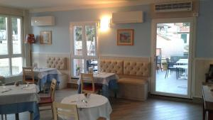A restaurant or other place to eat at Stella Della Marina