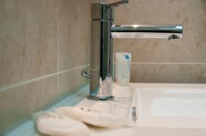 A bathroom at Ostria Inn