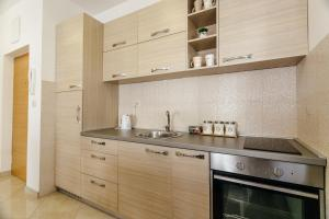 A kitchen or kitchenette at Apartments Rivijera
