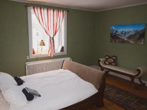 A bed or beds in a room at Smens Experience Retreat
