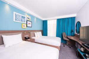 Un ou plusieurs lits dans un hébergement de l'établissement Hampton By Hilton Belfast City Centre