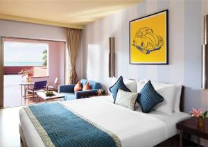 A bed or beds in a room at Cidade De Goa - IHCL SeleQtions