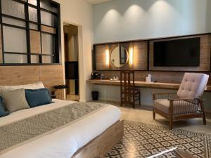 A bed or beds in a room at EL BOUTIQUE HOTEL