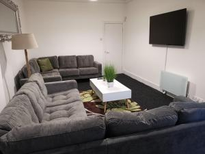 A seating area at CR Anfield Apartments