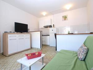 A television and/or entertainment centre at Apartment Riva Rabac 1825