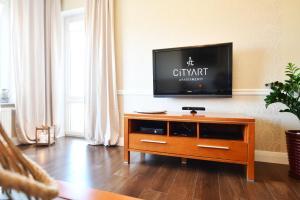 Telewizja i/lub zestaw kina domowego w obiekcie City Art Apartamenty w Rezydencji Maritimo