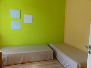 Ein Bett oder Betten in einem Zimmer der Unterkunft alte Apotheke