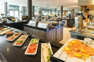 A restaurant or other place to eat at Van der Valk Hotel Mons Congres