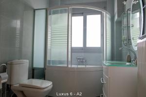 Ванная комната в Ionion Star Hotel