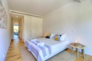 A bed or beds in a room at Beach House