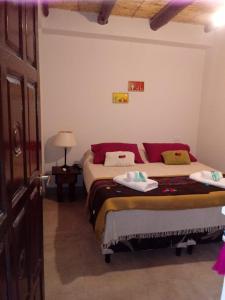 Una cama o camas en una habitación de Los Agustinos