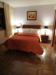 A bed or beds in a room at Hotel La Colmena - Huaraz