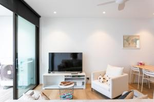 A television and/or entertainment center at ENCORE IV: Bondi Junction
